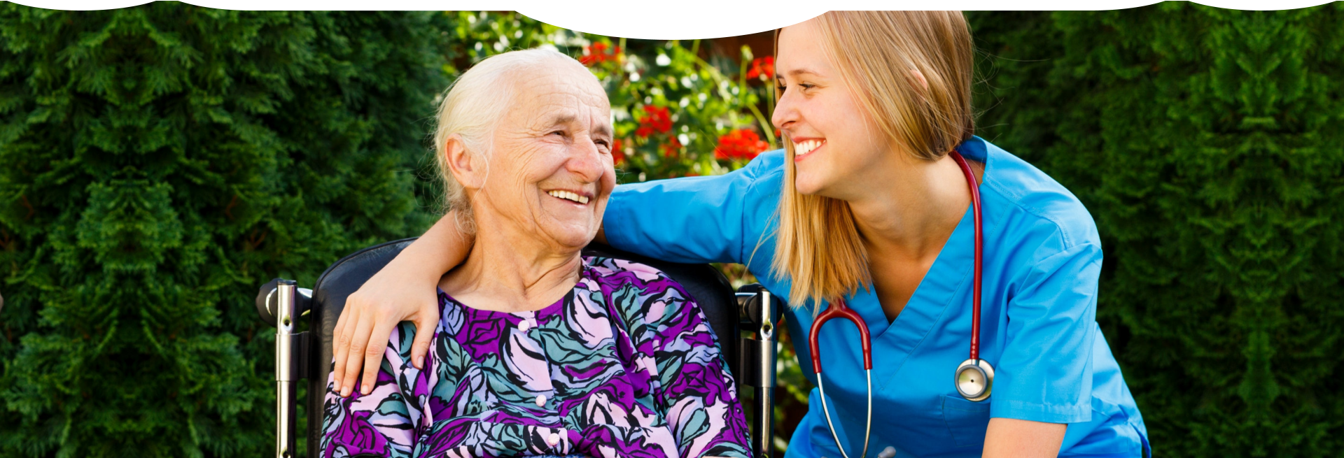 caregiver and patient smiling and looking at each other