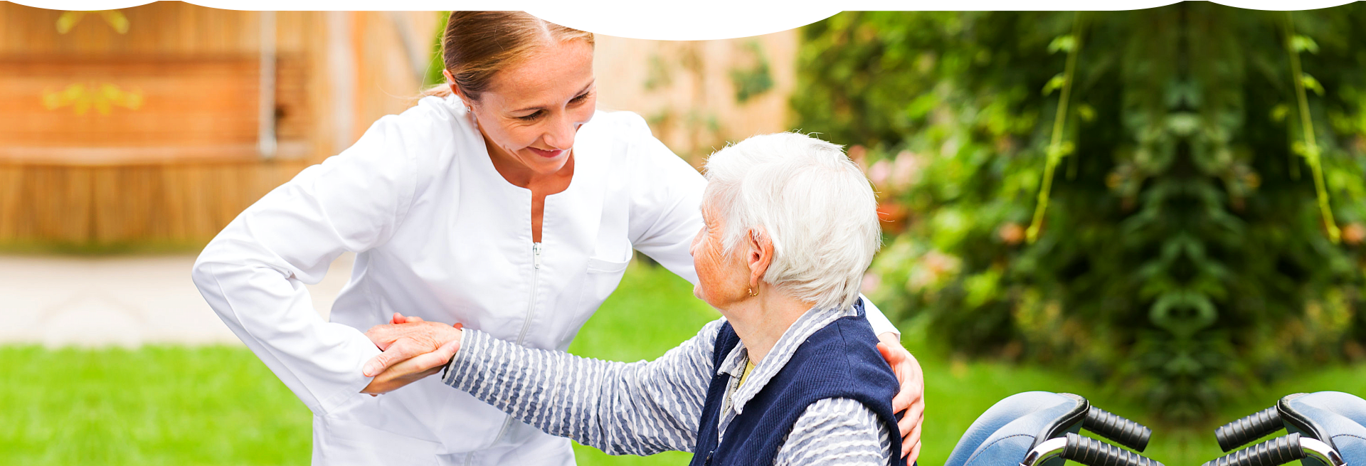 caregiver giving support to a sitting patient