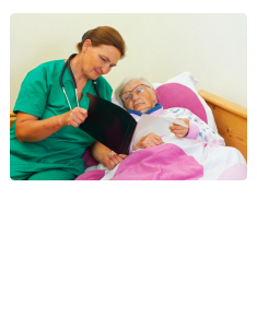 caregiver showing a xray result to old woman