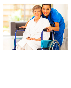 caregiver holding a patient in a wheel chair